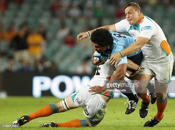 Wycliff Palu of the Waratahs is tackled during the round five Super Rugby match between the Waratahs and the Cheetahs at Sydney Football Stadium on...