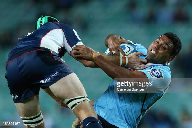 Wycliff Palu of the Waratahs is tackled during the round three Super Rugby match between the Waratahs and the Rebels at Allianz Stadium on March 1...