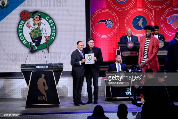 Wycliffe Grousbeck of the Boston Celtics and Mark Tatum Deputy Commissioner of the NBA smile during the 2017 NBA Draft Lottery at the New York Hilton...