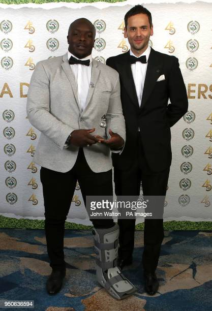 Wycombe Wanderers' Adebayo Akinfenwa and PFA chairman Ben Purkiss poses with the PFA League Two Team of the Year award during the 2018 PFA Awards at...