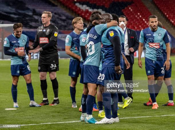 Wycombe Wanderers' Adebayo Akinfenwa celebrates promotion with team mate Matthew Bloomfield during the Sky Bet League One Play Off Final between...