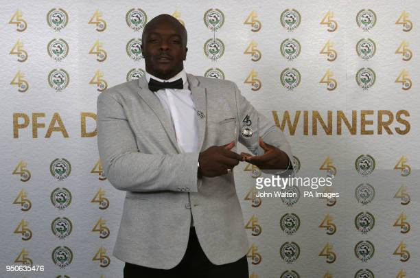 Wycombe Wanderers' Adebayo Akinfenwa poses with the PFA League Two Team of the Year award during the 2018 PFA Awards at the Grosvenor House Hotel...