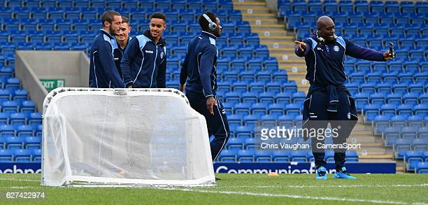 Wycombe Wanderers' Adebayo Akinfenwa right films his teammates ahead of the Emirates FA Cup Second Round game at Chesterfield before the Emirates FA...