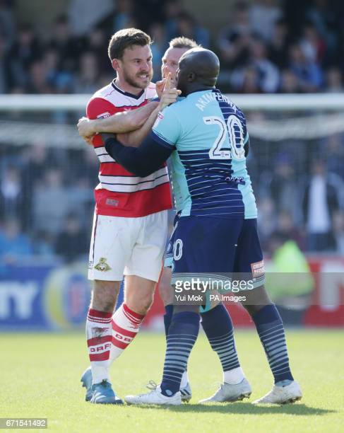 Wycombe Wanderers Adebayo Akinfenwa tries to calm down Doncaster Rovers Andy Butler during the Sky Bet League Two match at Adams Park Wycombe