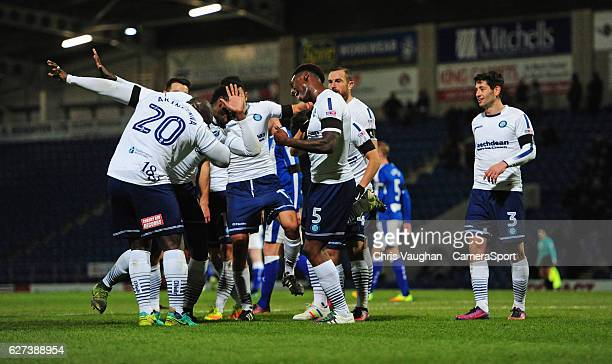 Wycombe Wanderers' Anthony Stewart celebrates scoring his sides fourth goal with teammates Aaron Pierre left and Adebayo Akinfenwa during the...