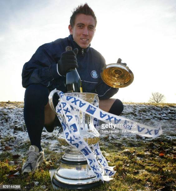 Wycombe Wanderers' Darren Currie poses with the AXA FA Cup at the club's training ground ahead of their third round match against Fulham THIS PICTURE...