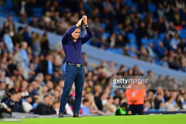 Wycombe Wanderers' English manager Gareth Ainsworth claps during a minute's applause in honour of the late Jimmy Greaves who died on Sunday, ahead of...