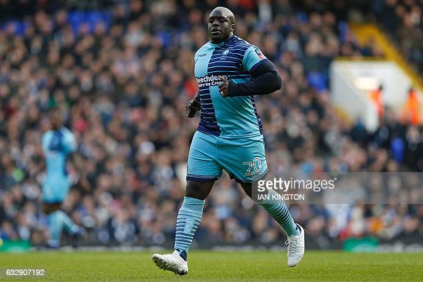 Wycombe Wanderers' English striker Adebayo Akinfenwa runs on the pitch during the English FA Cup fourth round football match between Tottenham...