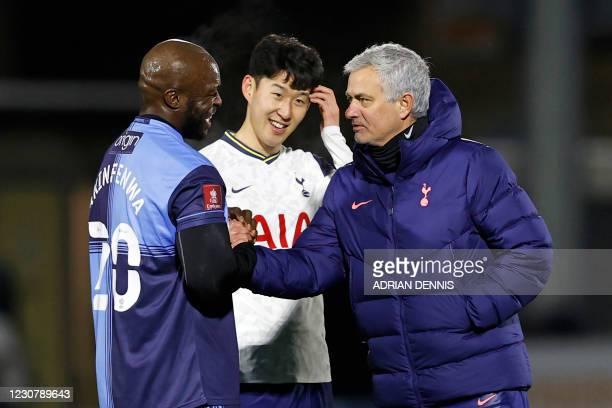 Wycombe Wanderers' English striker Adebayo Akinfenwa speaks with Tottenham Hotspur's South Korean striker Son Heung-Min and Tottenham Hotspur's...