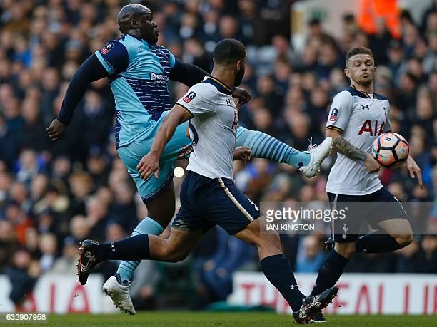 Wycombe Wanderers' English striker Adebayo Akinfenwa vies with Tottenham Hotspur's Englishborn US defender Cameron CarterVickers during the English...