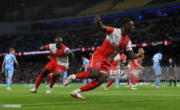 Wycombe Wanderers' English striker Brandon Hanlan celebrates scoring the opening goal during the English League Cup third round football match...