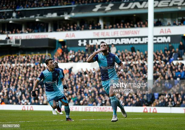 Wycombe Wanderers' English striker Paul Hayes celebrates after scoring from the penalty spot to score his team's second goal during the English FA...