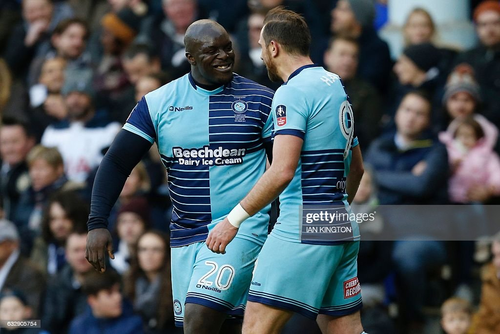 Wycombe Wanderers' English striker Paul Hayes (R) celebrates scoring his team's first goal with Wycombe Wanderers' English striker Adebayo Akinfenwa during the English FA Cup fourth round football match between Tottenham Hotspur and Wycombe Wanderers at White Hart Lane in London, on January 28, 2017. / AFP / Ian KINGTON / RESTRICTED TO EDITORIAL USE. No use with unauthorized audio, video, data, fixture lists, club/league logos or 'live' services. Online in-match use limited to 75 images, no video emulation. No use in betting, games or single club/league/player publications. /
