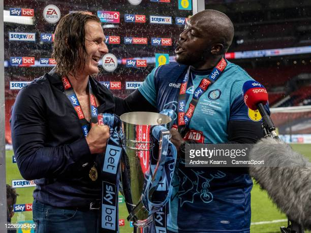 Wycombe Wanderers' Gareth Ainsworth and Adebayo Akinfenwa are interviewed by the media during the Sky Bet League One Play Off Final between Oxford...