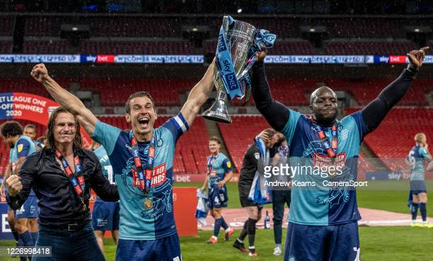 Wycombe Wanderers' Gareth Ainsworth Matthew Bloomfield and Adebayo Akinfenwa during the Sky Bet League One Play Off Final between Oxford United and...