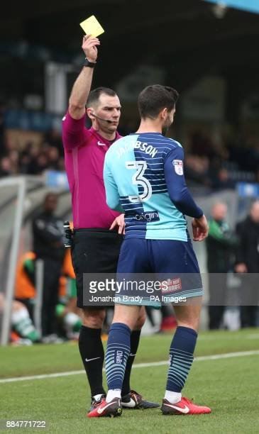 Wycombe Wanderers' Joe Jacobson is shown the yellow card during the Emirates FA Cup second round match at Adams Park Wycombe