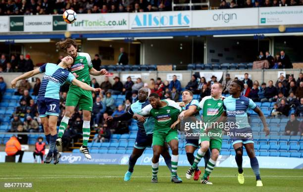 Wycombe Wanderers' Luke O'Nien and Leatherhead's Jack Midson battle in the air whilst their team mates watch during the Emirates FA Cup second round...