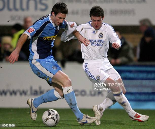 Wycombe Wanderer's Mike Williamson and Chelsea's Wayne Bridge in action
