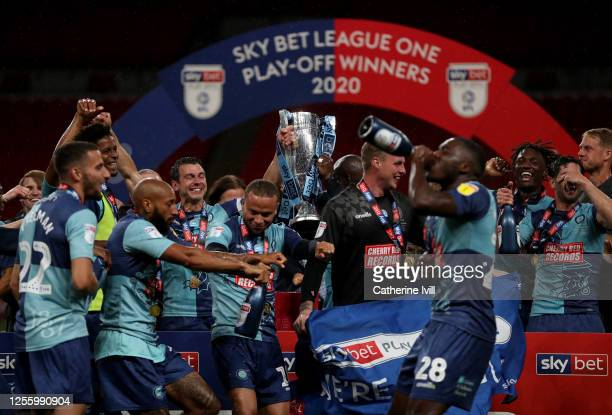 Wycombe Wanderers players celebrate after the Sky Bet League One Play Off Final between Oxford United and Wycombe Wanderers at Wembley Stadium on...