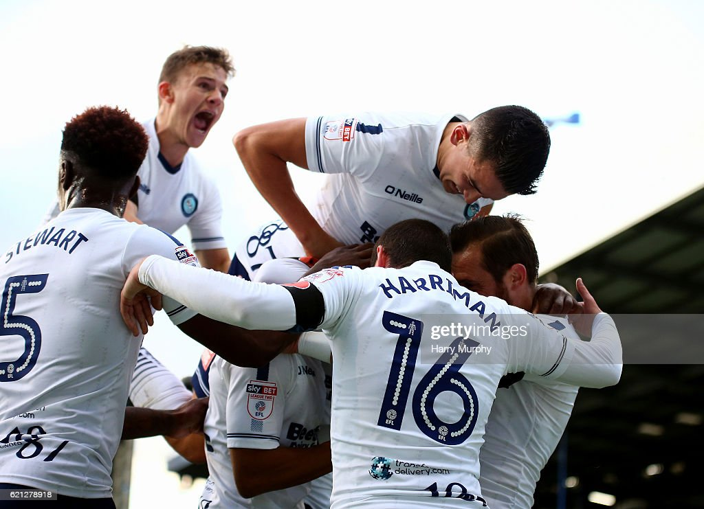 Wycombe Wanderers players celebrate their teams opening goal scored by Paris Cowan-Hall during the Emirates FA Cup First Round match between Portsmouth and Wycombe Wanderers at Fratton Park on November 5, 2016 in Portsmouth, England.