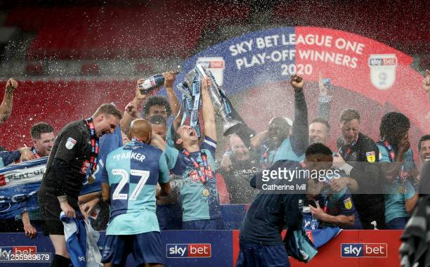 Wycombe Wanderers plyers celebrate after the Sky Bet League One Play Off Final between Oxford United and Wycombe Wanderers at Wembley Stadium on July...
