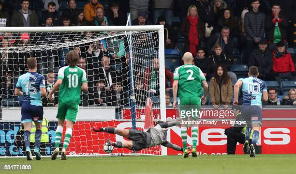 Wycombe Wanderers' Sam Saunders' shot beats Leatherhead's goalkeeper Zaki Oualah to score his side's first goal during the Emirates FA Cup second...