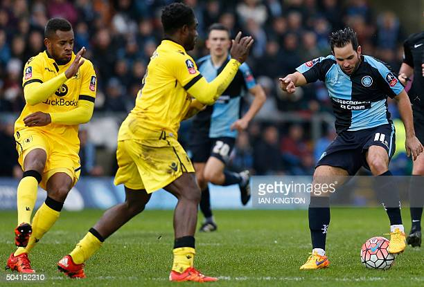 Wycombe Wanderers' Sam Wood vies with Aston Villas Micah Richards and Aston Villa's Dutch midfielder Leandro Bacuna during the FA Cup third round...