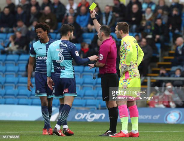 Wycombe Wanderers' Sido Jombati is shown the yellow card during the Emirates FA Cup second round match at Adams Park Wycombe