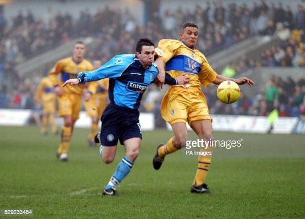 Wycombe Wanderers' Stuart Robert battles for the ball against Mansfield Town's Colin Little during their Nationwide Division Two match at Mansfield...