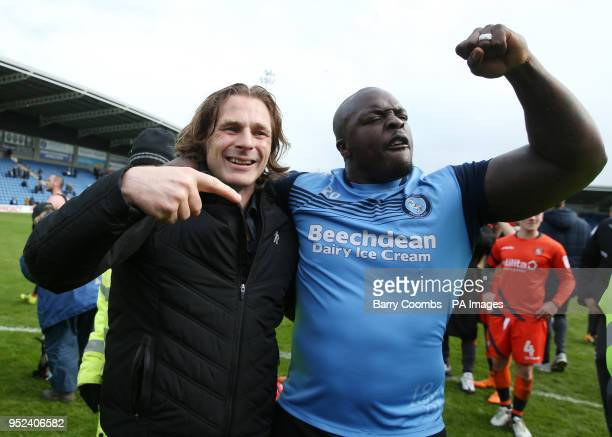 Wycombe's manager Gareth Ainsworth and Adebayo Akinfenwa celebrate promotion to League One during the Sky Bet League Two match at the Proact...