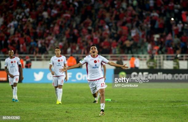Wydad Athletic Club's Achraf Bencharki celebrates vitory over Mamelodi Sundowns following the CAF Champions League quarterfinal match between...