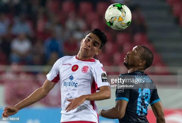 Wydad Athletic Club's Achraf Bencharki vies for the ball with Mamelodie Sundowns's Samuel Tiyani Mabunda during the CAF Champions League quarterfinal...