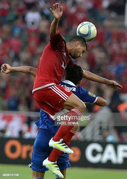 Wydad Athletic Club's Mohammed Ounnajem vies for the ball with Al Ahly Sporting Club's Amr Gamal Sayed during the 20th edition of the CAF Champion...