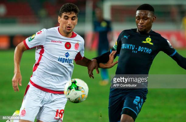 Wydad Athletic Club's Walid El karti vies for the ball with Mamelodi Sundowns's Mot Jeka Madisha during the CAF Champions League quarterfinal match...