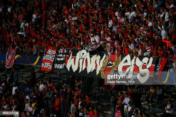 Wydad Casablanca supporters enjoy the atmosphere during the FIFA Club World Cup quarterfinal match between CF Pachuca and Wydad Casablanca at Zayed...