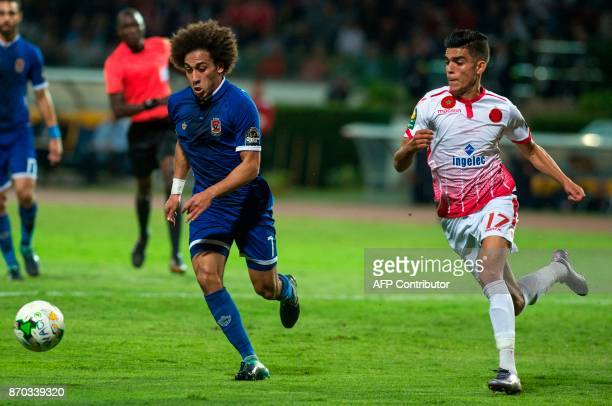 Wydad Casablanca's Achraf Bencharki vies for the ball against AlAhly's Sherif Ekramy Ahmed during the CAF Champions League final football match...
