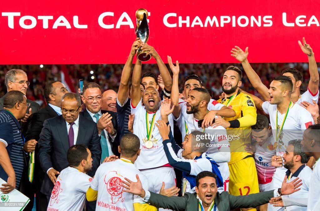 Wydad Casablanca's players celebrate with their trophy after winning the CAF Champions League final football match between Egypt's Al-Ahly and Morocco's Wydad Casablanca on November 4, 2017, at Mohamed V Stadium in Casablanca. /