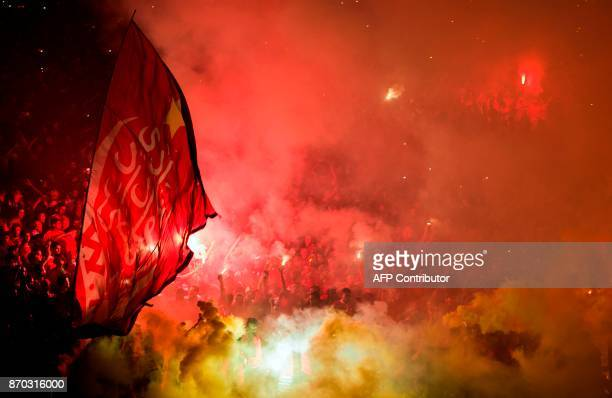 Wydad Casablanca's supporters celebrate after their team won the CAF Champions League final football match between Egypt's AlAhly and Morocco's Wydad...