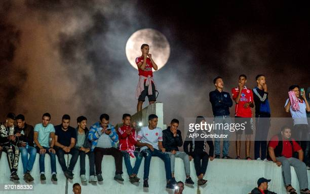 Wydad Casablanca's supporters cheer for their team before the start of the CAF Champions League final football match between Egypt's AlAhly and...
