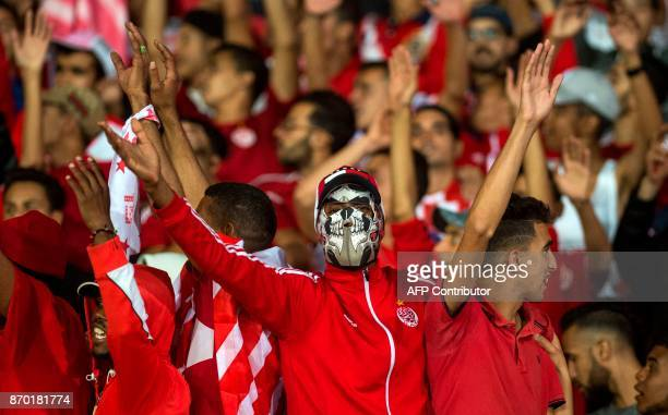 Wydad Casablanca's supporters gesture before the start of the CAF Champions League final football match between Egypt's AlAhly and Morocco's Wydad...