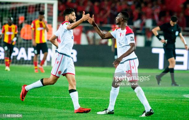 Wydad's Cheick Comara celebrates with a teamamte after scoring a goal during the CAF champion league final 2019 1st leg football match between...
