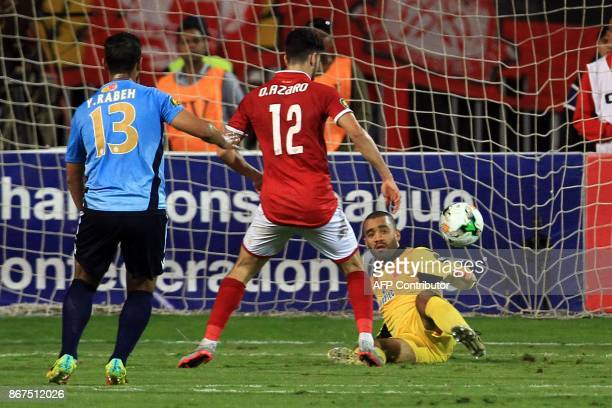 Wydad's goalkeeper Zouheir Laaroubi vies for the ball with Ahly's forward Walid Azaro during the CAF Champions League final football match between...