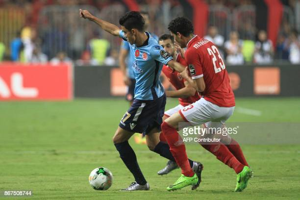 Wydad's striker Achraf Bencharki vies for the ball with Ahly's defender Mohamed Nagieb during the CAF Champions League final football match between...