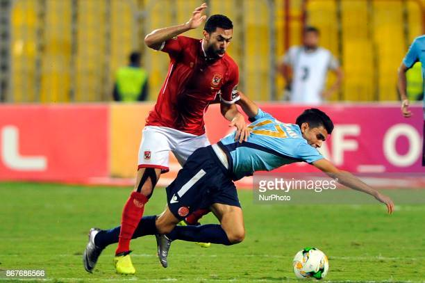 Wydad's striker Achraf Bencharki vies for the ball with Ahly's Defender Ahmed Fathi during the CAF Champions League final football match between...