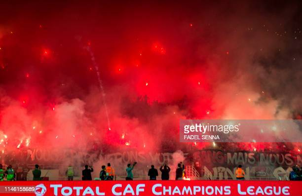 Wydad's supporters light flares during the CAF champion league final 2019 1st leg football match between Morocco's Wydad Athletic Club and Tunisia's...