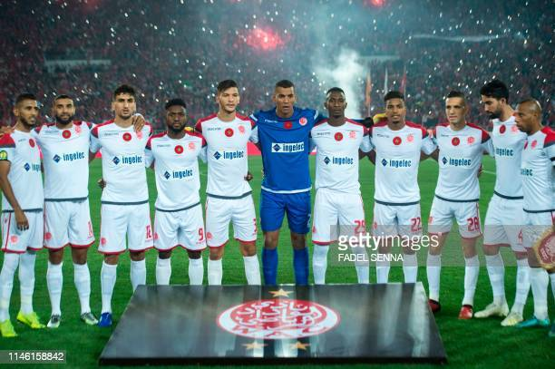 Wydad's team poses for pictures before the CAF champion league final 2019 1st leg football match between Morocco's Wydad Athletic Club and Tunisia's...