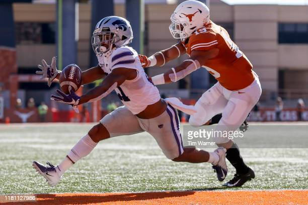 Wykeen Gill of the Kansas State Wildcats catches a pass for a touchdown in the first half defended by Brandon Jones of the Texas Longhorns at Darrell...