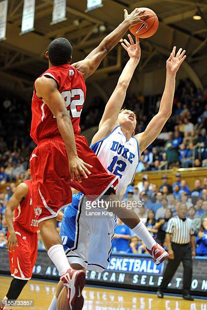 WyKevin Bazemore of the WinstonSalem State Rams blocks a shot by Alex Murphy of the Duke Blue Devils at Cameron Indoor Stadium on November 1 2012 in...