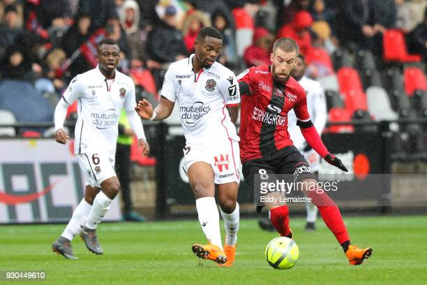 Wylan Cyprien of Nice and Lucas Deaux of Guingamp during the Ligue 1 match between EA Guingamp and OGC Nice at Stade du Roudourou on March 11 2018 in...