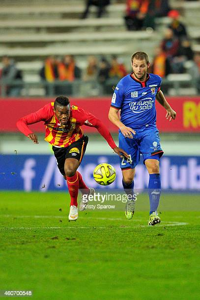 Wylan Cyprien of RC Lens and Mathieu Bodmer of OGC Nice in action during the Ligue 1 match between RC Lens and OGC Nice at Stade de la Licorne on...